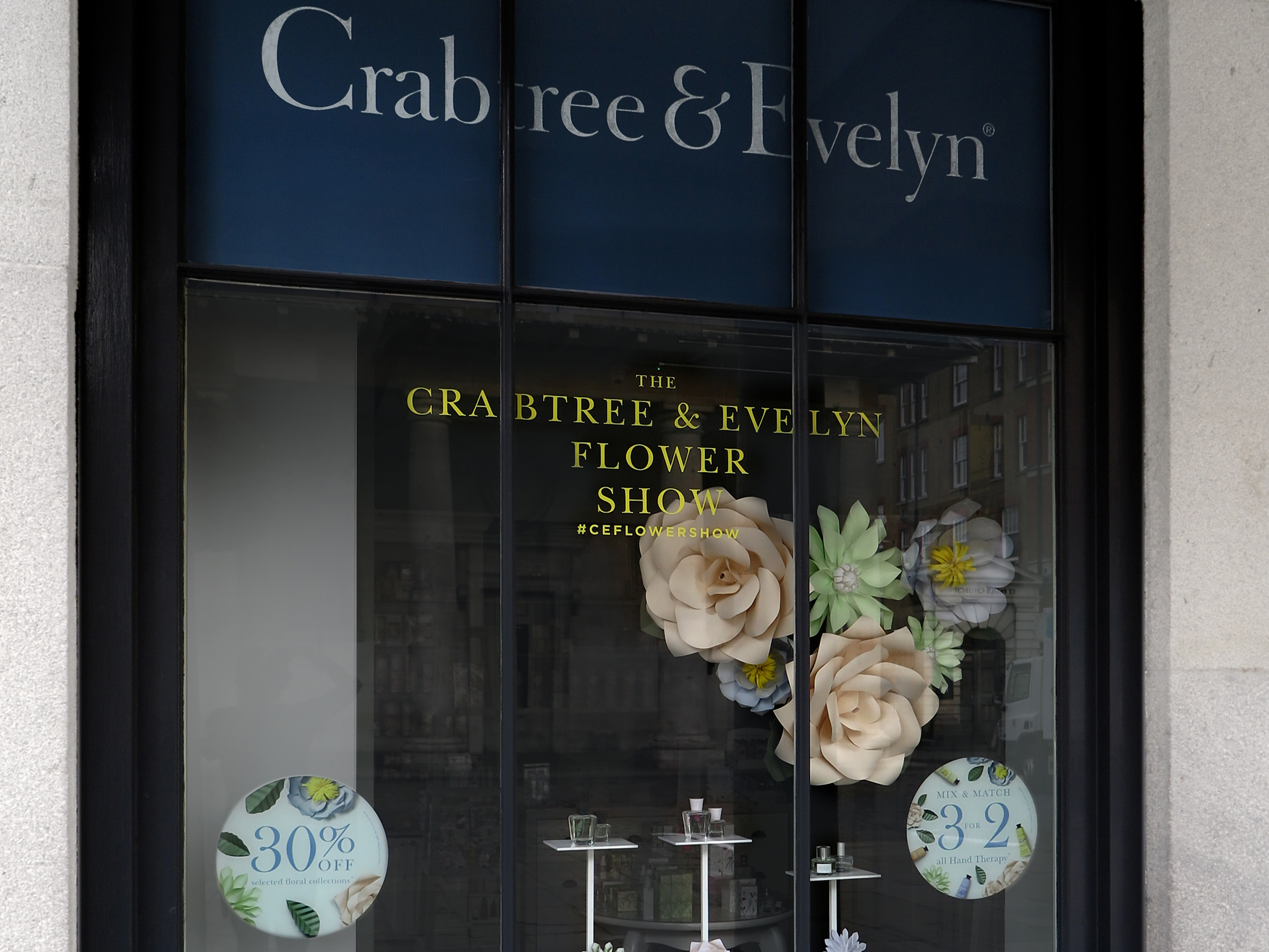 Custom designed giant paper flowers and manufacture for 3 UK stores