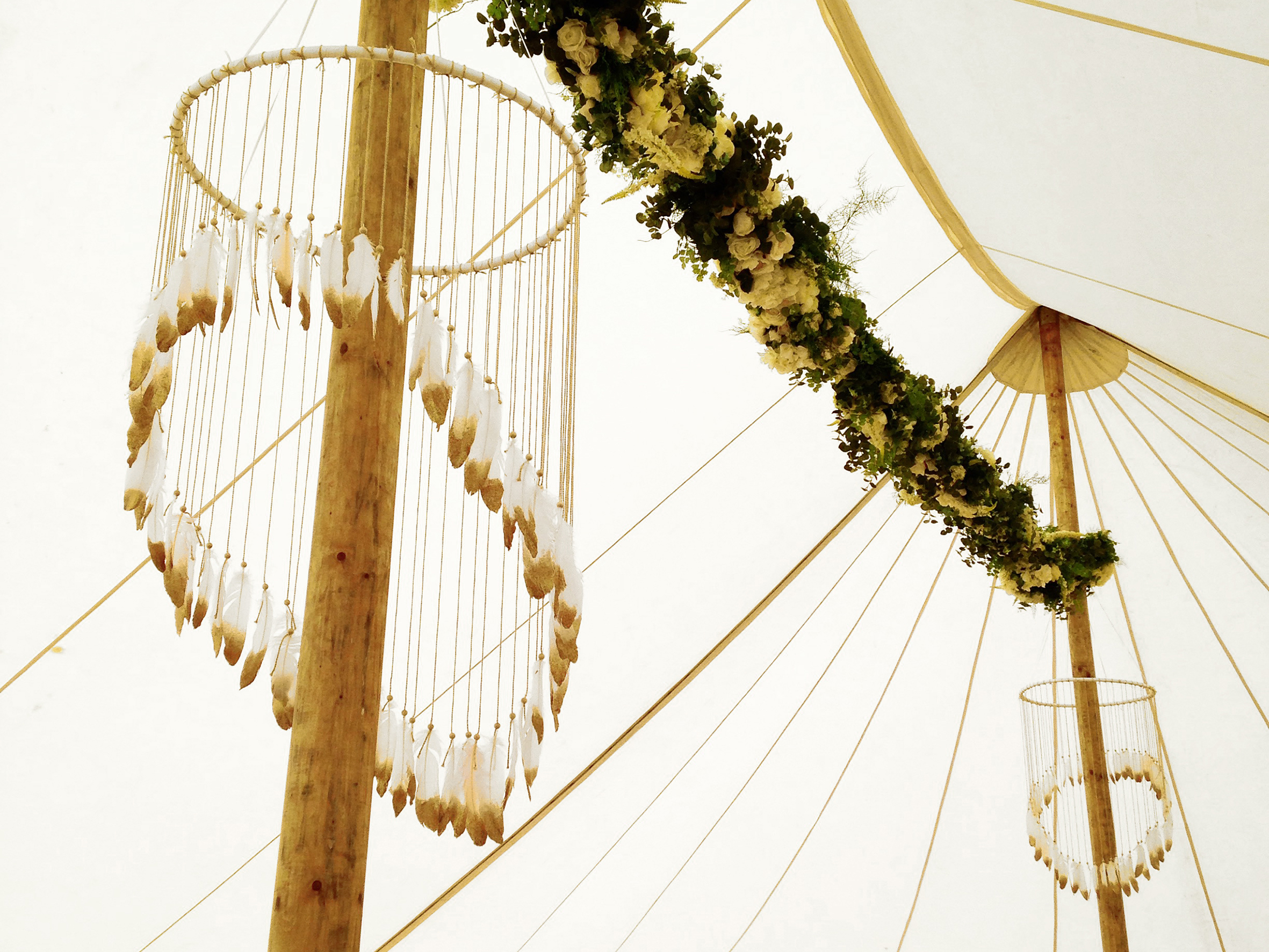 Bespoke handmade gold dipped feather chandleiers and giant dream catcher