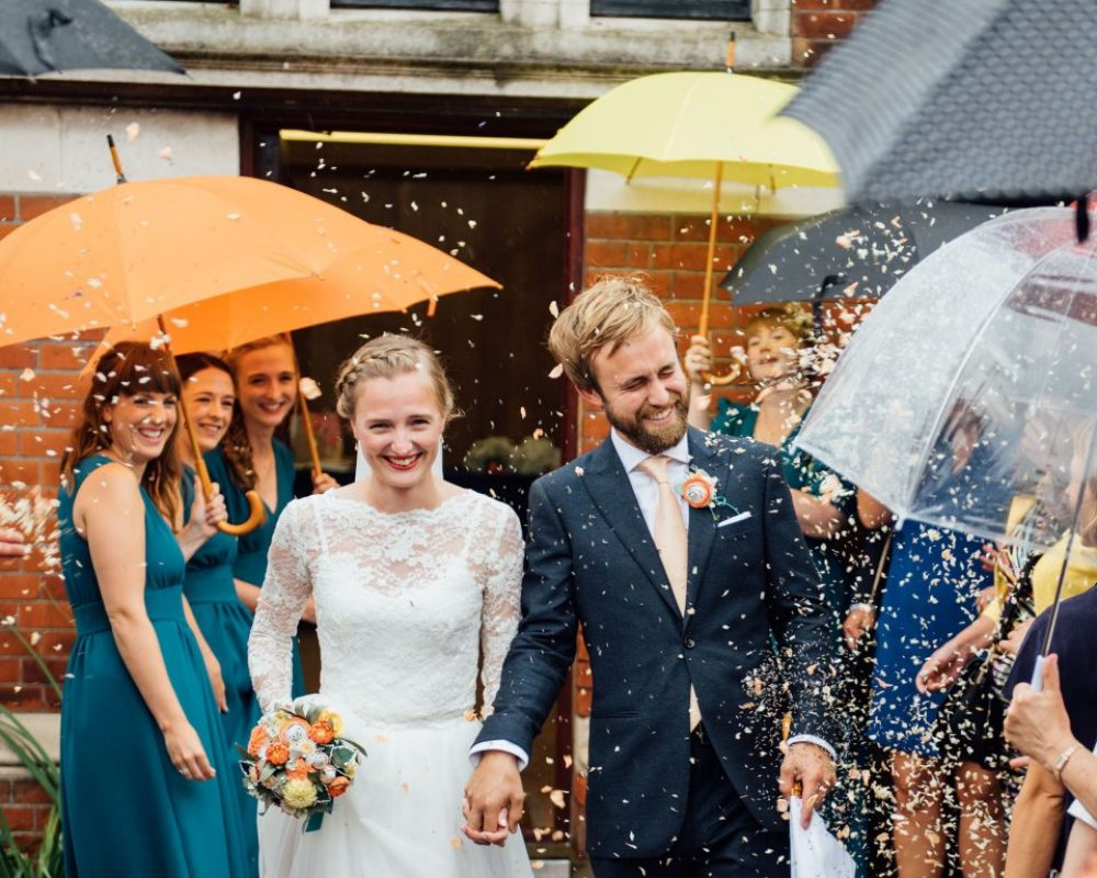 bride-and-groom-with-colourful-umbrella